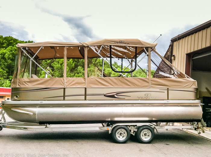 The clear enclosure with replaceable screen panels allow the owners of this party barge to enjoy it all year!