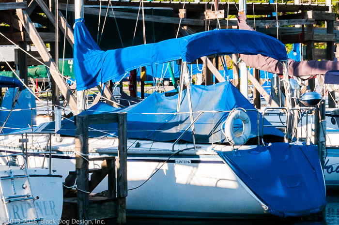 The custom covers on this Hunter sailboat not only protect the cockpit and bimini, but there is also a cover to protect the boat's artwork on its stern!
