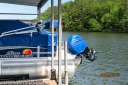 The full cover for this barge includes the boat cover, the bimini cover, and a matching motor cover.