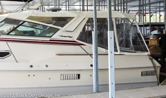 Classic Searay cruiser gets two bimini tops and a new enclosure.