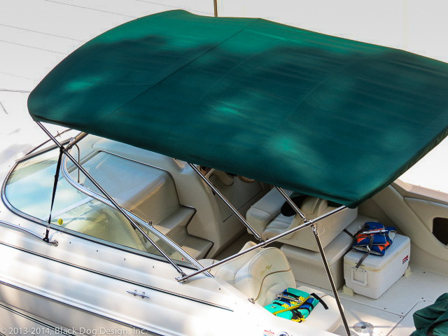 This new bimini provides a large amount of shade to the customer and his family. Beautiful top.