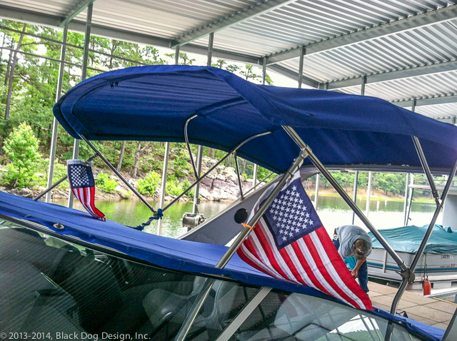 The Tonneau Cover provides protection, and the Bimini provides shade.